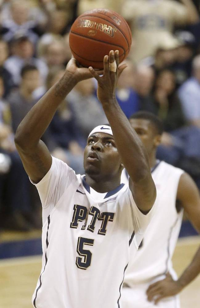 In this photo from Saturday, Jan. 11, 2014, Pittsburgh's Durand Johnson shoots a foul shot in the NCAA college basketball game between Pittsburgh and Wake Forest. Johnson will miss the rest of the season after tearing the ACL and meniscus in the game. He is expected to undergo surgery within the next week and to be back in 9 to 12 months