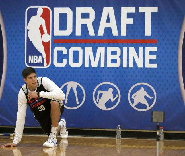 Doug McDermott, from Creighton, stretches before participating in the 2014 NBA basketball draft combine Friday, May 16, 2014, in Chicago