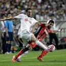 Germany Leverkusen's Roberto Hilbert, left, fights for the ball against South Korea's club FC Seoul's Everton during their friendly soccer match at the Seoul World Cup Stadium in Seoul, South Korea, Wednesday, July 30, 2014