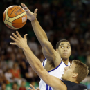 Germany's Heiko Schaffartzik, right, challenges for the ball with Britain's Myles Hesson, during their EuroBasket European Basketball Championship Group A match in Ljubljana, Slovenia, Sunday, Sept. 8, 2013. (AP Photo/Darko Bandic)