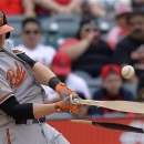 Orioles outfielder Nolan Reimold has a slight tear in his right hamstring photo