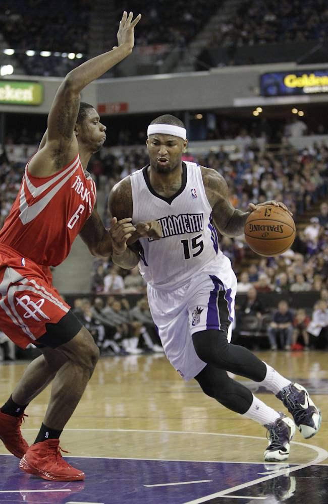 Sacramento Kings center DeMarcus Cousins, right, drives against Houston Rockets forward Terrence Jones during the third quarter of an NBA basketball game in Sacramento, Calif., Tuesday Feb. 25, 2014.  The Rockets won 129-103