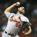 St. Louis Cardinals' Michael Wacha throws a pitch against the Arizona Diamondbacks during the first inning of a baseball game Friday, Sept. 26, 2014, in Phoenix. (AP Photo/Ross D. Franklin)