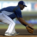 Kansas City Royals' Jayson Nix handles a ground ball during batting practice before the start of the AL wild-card playoff baseball game against the Oakland Athletics Tuesday, Sept. 30, 2014, in Kansas City, Mo. (AP Photo/Jeff Roberson)