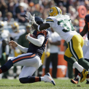 Chicago Bears quarterback Jay Cutler (6) slides as Green Bay Packers cornerback Sam Shields (37) tries to tackle him in the first half of an NFL football game Sunday, Sept. 28, 2014, in Chicago. The Associated Press