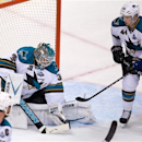 San Jose Sharks goalie Antti Niemi, left, of Finland, makes the save as Marc-Edouard Vlasic (44) defends against Vancouver Ca