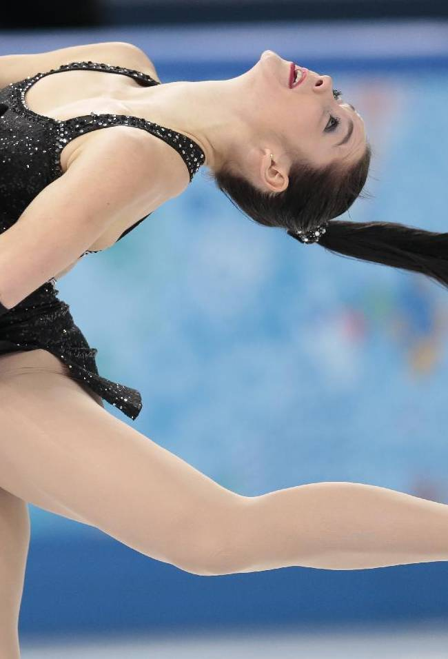 Kaetlyn Osmond of Canada competes in the women's short program figure skating competition at the Iceberg Skating Palace during the 2014 Winter Olympics, Wednesday, Feb. 19, 2014, in Sochi, Russia
