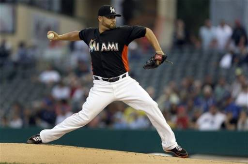 Miami Marlins starting pitcher Ricky Nolasco throws during the first inning of an exhibition spring training baseball game against the New York Mets, Friday, March 22, 2013, in Jupiter, Fla