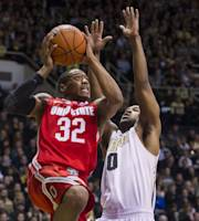 Ohio State's Lenzelle Smith Jr. (32) drives to the basket against Purdue's Terone Johnson (0) in the first half of an NCAA college basketball game, Tuesday, Dec. 31, 2013, in West Lafayette, Ind. (AP Photo/Doug McSchooler)