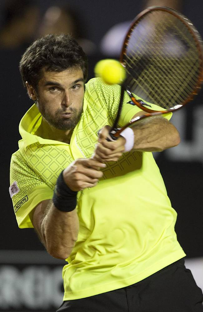 Pablo Andujar of Spain returns the ball to Rafael Nadal of Spain during a semifinals match at the Rio Open tennis tournament in Rio de Janeiro, Brazil, Saturday, Feb. 22, 2014