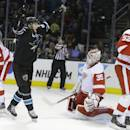San Jose Sharks' Melker Karlsson, second from left, celebrates a goal made by Matt Irwin, not seen, past Detroit Red Wings goalie Jimmy Howard (35) during the first period of an NHL hockey game Thursday, Feb. 26, 2015, in San Jose, Calif. At left is Detroit's Justin Abdelkader (8) and at right is Jonathan Ericsson (52). (AP Photo/Ben Margot)