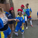 Women  of the Borel slum prepare to play a soccer match during a symbolic tournament called Popular Cup in Rio de Janeiro, Brazil, Saturday, June 15, 2013.  Communities being threatened with forced removal compete for the cup in protest for what they consider a discrimination towards low-income residents in the name of big sporting events such as the Confederations Cup. (AP Photo/Silvia Izquierdo)