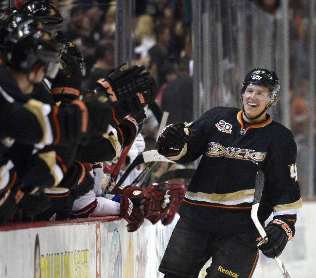 Anaheim Ducks defenseman Hampus Lindholm, of Sweden, celebrates his goal with teammates during the first period of an NHL hockey game against the Phoenix Coyotes, Wednesday, Nov. 6, 2013, in Anaheim, Calif