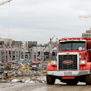 A truckload of debris is removed from the Metrodome demolition site in Minneapolis, Thursday, April 17, 2014. Project leaders for the new Minnesota Vikings stadium says the demolition of the team's old home was formally completed Thursday The Associated P