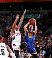 PORTLAND, OR - APRIL 13: Stephen Curry #30 of the Golden State Warriors shoots against the Portland Trail Blazers on April 13, 2014 at the Moda Center Arena in Portland, Oregon. (Photo by Sam Forencich/NBAE via Getty Images)
