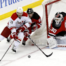 Carolina Hurricanes right wing Patrick Dwyer (39) competes for the puck with New Jersey Devils defenseman Andy Greene (6) as goalie Martin Brodeur protects his net during the third period of an NHL hockey game, Saturday, March 8, 2014, in Newark, N.J. The