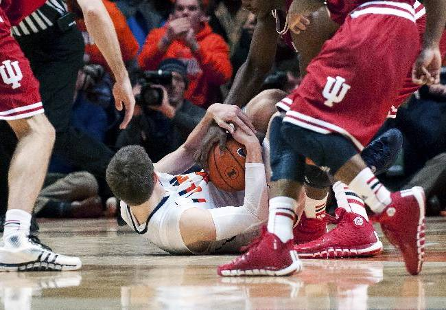Illinois forward Jon Ekey, bottom, comes up with a steal during overtime of an NCAA college basketball game against Indiana in Champaign, Ill. on Tuesday, Dec. 31, 2013