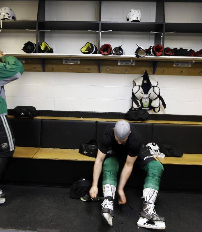 Dallas Stars' Jamie Benn, right, removes his skates as teammate Ray Whitney prepares to remove his jersey following an NHL hockey practice Tuesday, March 11, 2014, in St. Louis. Dallas Stars' Rich Peverley is undergoing testing to determine what triggered his collapse during a game Monday night in Dallas. The Stars are scheduled to play the St. Louis Blues tonight in St. Louis