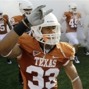 FILE - In this Sept. 11, 2010, file photo, Texas' Jordan Hicks (33) takes the field with teammates to face Wyoming in an NCAA college football game in Austin, Texas. Texas has sent home Hicks and backup quarterback Case McCoy on the eve of the Alamo Bowl in San Antonio for violating team rules, a person with knowledge of the suspensions told The Associated Press. The person spoke to the AP on condition of anonymity Friday, Dec. 28, 2012, because the school wasn't releasing the names of the suspended players. (AP Photo/Eric Gay, File)