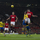 Manchester United s Robin van Persie, second right, scores against Arsenal during their English Premier League soccer match at Old Trafford Stadium, Manchester, England, Saturday Nov. 10, 2013