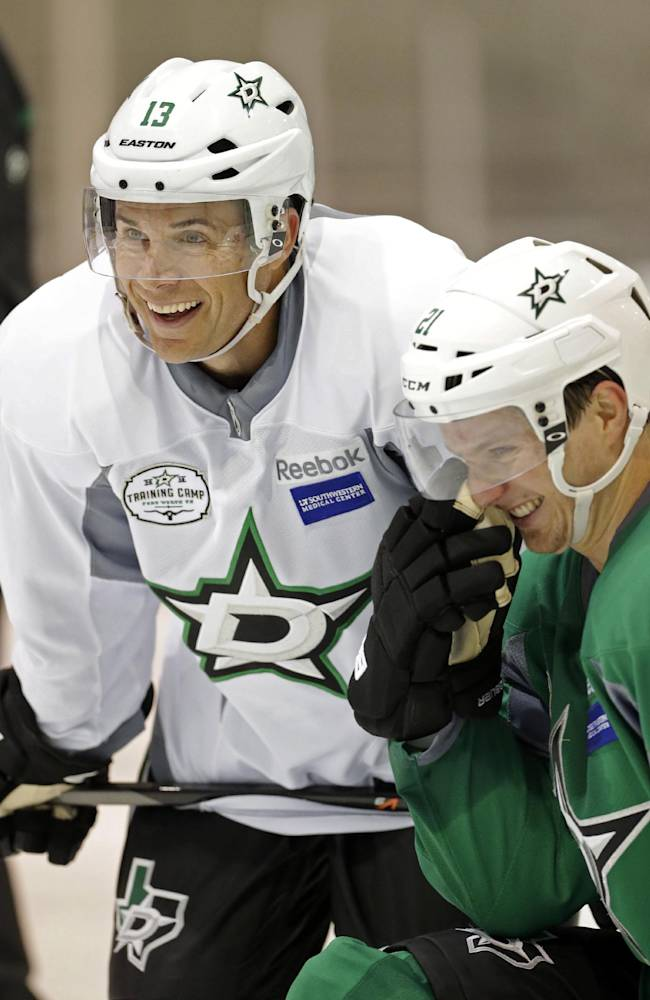 Dallas Stars left wings Ray Whitney (13) and Antoine Roussel (21) share a laugh during NHL hockey camp Thursday, Sept. 19, 2013, in Frisco, Texas