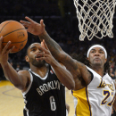 Brooklyn Nets forward Alan Anderson, left, puts up a shot as Los Angeles Lakers forward Jordan Hill defends during the first half of an NBA basketball, Sunday, Feb. 23, 2014, in Los Angeles The Associated Press