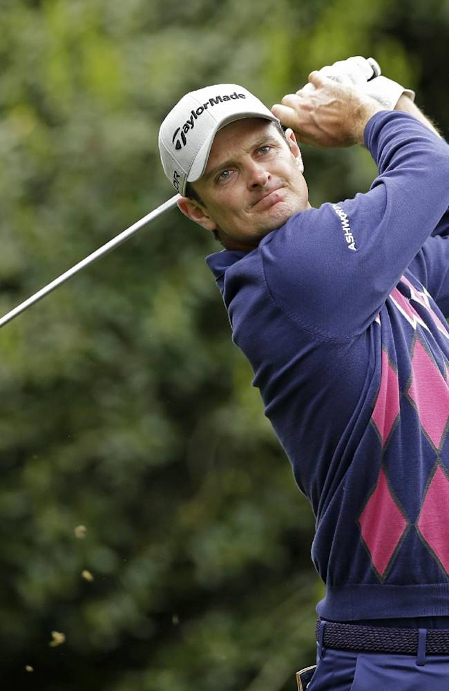 Justin Rose, of England, watches his tee shot on the 14th hole during the second round of the Wells Fargo Championship golf tournament in Charlotte, N.C., Friday, May 2, 2014