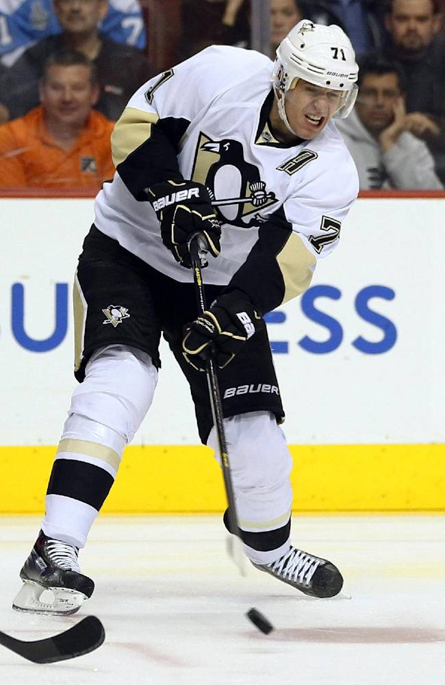 Pittsburgh Penguins' Evgeni Malkin fires a pass across ice in the first period of an NHL hockey game agaisnt the Philadelphia Flyers, Thursday, Oct. 17, 2013, in Philadelphia. The Penguins won 4-1