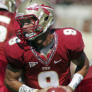 Florida State's Clint Trickett (9) rolls out in the second quarter in the second quarter of their NCAA college football spring game, Saturday, April 14, 2012, in Tallahassee, Fla. (AP Photo/Phil Sears)