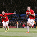 Manchester United's Robin van Persie, right, celebrates scoring their third goal, and his hat-trick against Olympiakos, with team-mate Wayne Rooney, left, during the UEFA Champions League, Round of 16, second leg match at Old Trafford, Manchester, England