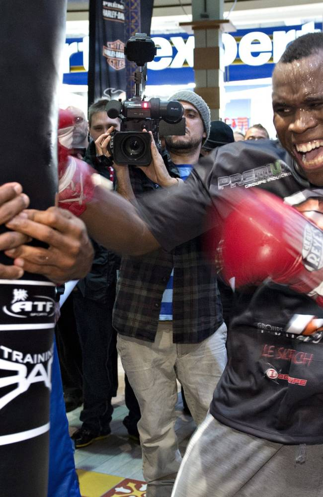 WBC light heavyweight champion Adonis Stevenson works out during a public training session Tuesday, Nov. 26, 2013,  in Quebec City. Stevenson will fight Tony Bellew of Liverpool, England in a title fight on Saturday