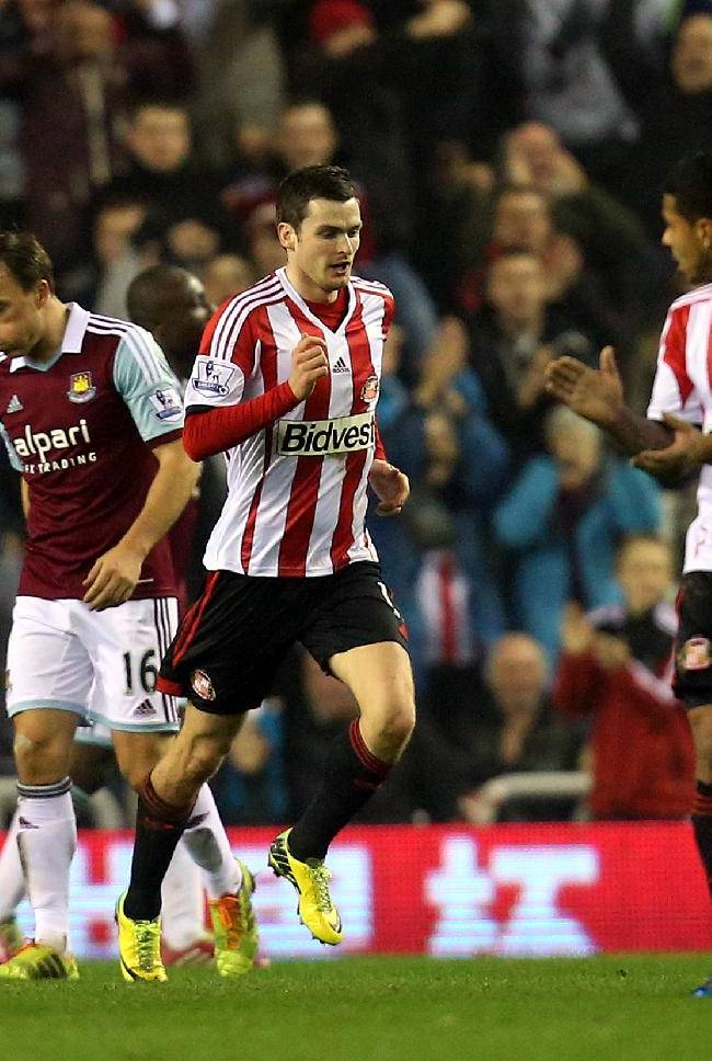 Sunderland's Adam Johnson, center, celebrates his goal  during their English Premier League soccer match against West Ham United at the Stadium of Light, Sunderland, England, Monday, March 31, 2014