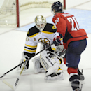 Washington Capitals right wing Troy Brouwer (20) goes for the puck against Boston Bruins goalie Chad Johnson (30) during the third period of an NHL hockey game, Saturday, March 29, 2014, in Washington. The Bruins won 4-2 The Associated Press