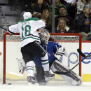 Dallas Stars right wing Patrick Eaves (18) scores a goal against Colorado Avalanche goalie Calvin Pickard during the first period of an NHL hockey game Saturday, Nov. 29, 2014, in Denver The Associated Press