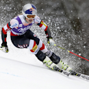 Lindsey Vonn, of the United States, speeds down the course during the first run of an alpine ski, women's World Cup giant slalom race, at the World Cup finals in Meribel, France, Sunday, March 22, 2015. (AP Photo/Shinichiro Tanaka)