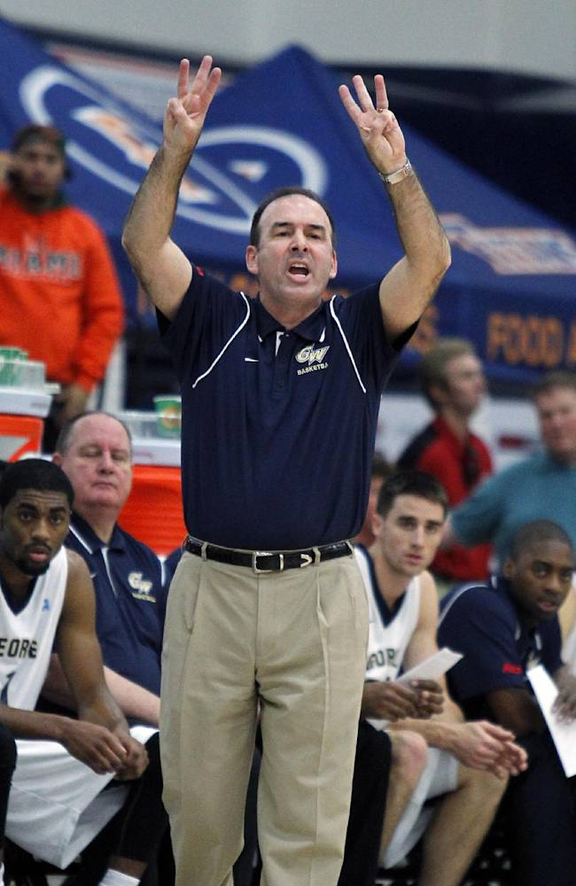 George Washington head coach Mike Lonergan calls in a play against Miami in the first half at the Wooden Legacy NCAA college basketball tournament, Thursday, Nov. 28, 2013, in Fullerton, Calif
