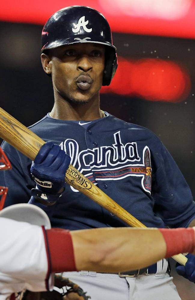 In this Aug. 6, 2013 file photo, Atlanta Braves' B.J. Upton reacts after a called third strike during the ninth inning of a baseball game against the Washington Nationals at Nationals Park in Washington. Spring training is Upton's chance for a fresh start after hitting .184 and losing his starting job in his Atlanta debut
