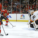 Chicago Blackhawks center Michal Handzus (26) scores past Philadelphia Flyers goalie Ray Emery, right, off a pass from Marcus Kruger, left, during the second period of an NHL hockey game on Wednesday, Dec. 11, 2013, in Chicago The Associated Press