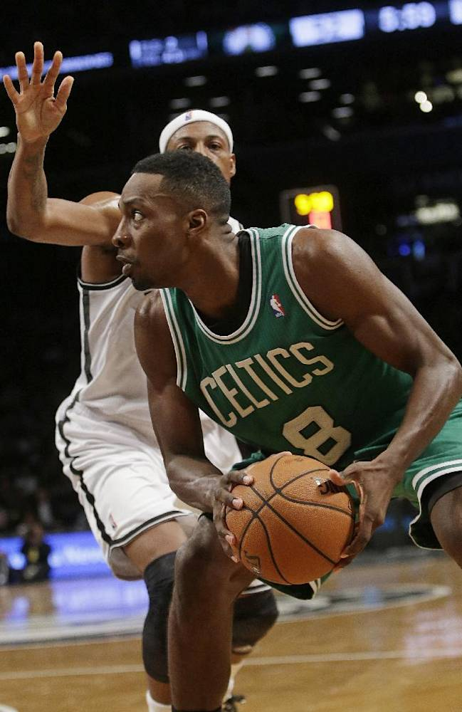 Boston Celtics' Jeff Green (8) drives past Brooklyn Nets' Paul Pierce during the second half of a preseason NBA basketball game Tuesday, Oct. 15, 2013, in New York.  The Nets won 82-80