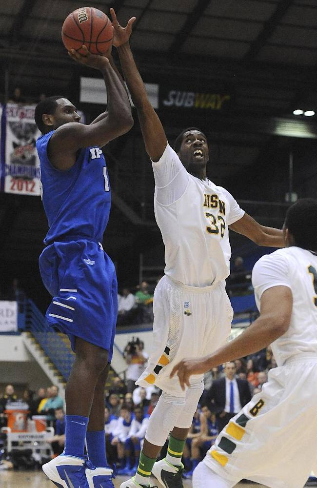 Indiana-Purdue-Fort Wayne's Luis Jacobo shoots over North Dakota State's Trayvonn Wright during the first half of an NCAA college basketball game for the Summit League men's tournament title, Tuesday, March 11, 2014, in Sioux Falls, S.D. North Dakota State won 60-57