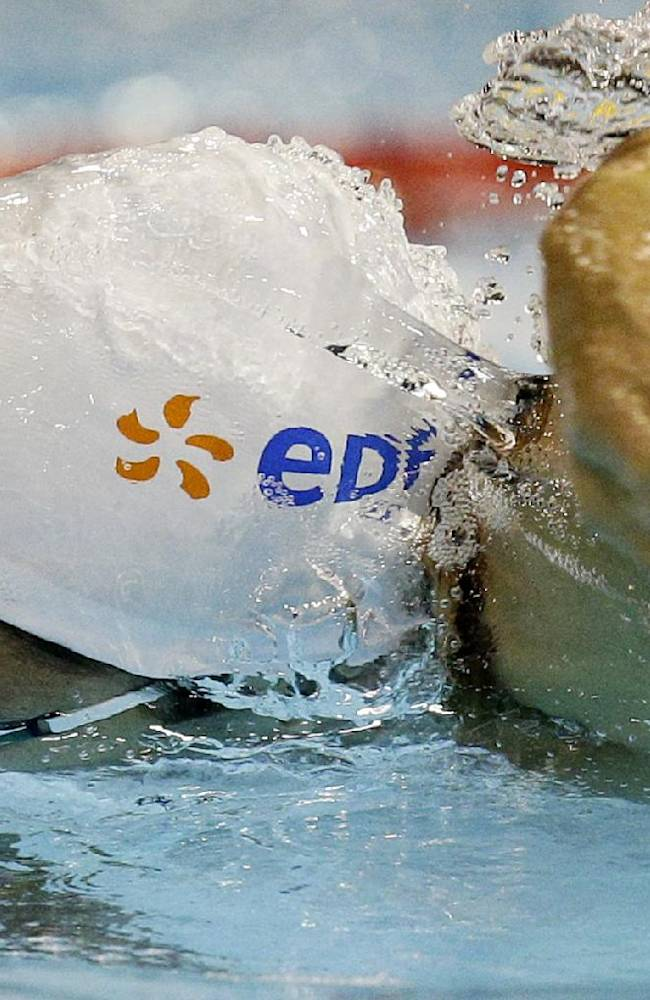 France's Florent Manaudou competes in a men's 100m freestyle first round heat at the LEN Swimming European Championships in Berlin, Germany, Thursday, Aug. 21, 2014