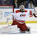 Carolina Hurricanes goalie Cam Ward (30) makes a glove save in the second period of a preseason NHL hockey game against the St. Louis Blues, Tuesday, Sept. 30, 2014 in St. Louis The Associated Press