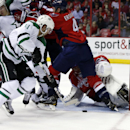 Dallas Stars center Dustin Jeffrey (11) reaches in for the puck to shoot his goal past Washington Capitals goalie Jaroslav Halak (41), from the Czech Republic, in the second period of an NHL hockey game, Tuesday, April 1, 2014, in Washington The Associate