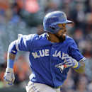 Toronto Blue Jays' Jose Reyes runs down the first base line during a baseball game against the Baltimore Orioles, Sunday, April 12, 2015, in Baltimore. (AP Photo/Patrick Semansky)
