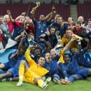 The French team celebrates with the trophy after winning the Under-20 World Cup Final soccer match between France and Uruguay at Ali Sami Yen Arena in Istanbul, Turkey, Saturday, July 13, 2013. France won the Under-20 World Cup for the first time after drawing with Uruguay 0-0 after extra time and winning the penalty shootout 4-1 on Saturday. (AP Photo/Gero Breloer)