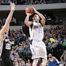 DALLAS, TX - DECEMBER 20: Devin Harris #20 of the Dallas Mavericks shoots a jumper against the San Antonio Spurs on December 20, 2014 at the American Airlines Center in Dallas, Texas. (Photo by Glenn James/NBAE via Getty Images)