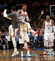 OKLAHOMA CITY, OK - APRIL 3: The Oklahoma City Thunder celebrate during a game against the San Antonio Spurs on April 3, 2014 at the Chesapeake Energy Arena in Oklahoma City, Oklahoma. (Photo by Layne Murdoch/NBAE via Getty Images)