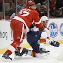 Detroit Red Wings defenseman Kyle Quincey (27) checks Florida Panthers center Vincent Trocheck (21) in the first period during an NHL hockey game in Detroit Tuesday, Dec. 2, 2014 The Associated Press