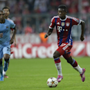 Bayern's David Alaba plays the ball during the Champions League Group E soccer match between FC Bayern Munich and Manchester City at Allianz Arena in Munich, southern Germany, Wednesday Sept. 17, 2014