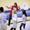 Atlanta Falcons' Steven Jackson dances with students at Shiloh Point Elementary School as part of the NFL's Play 60 Campaign to encourage kids to get 60 minutes of exercise a day, Tuesday, Dec. 3, 2013, in Cumming, Ga. Jackson addressed a special assembly